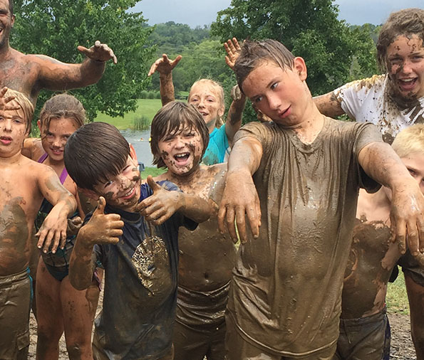 mud fight at Camp Hi-Ho lake