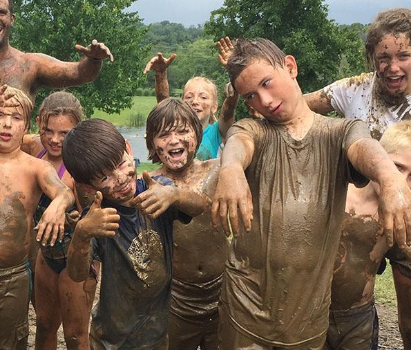 mud fight at Camp Hi-Ho lake